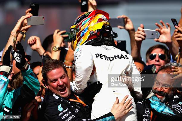 Race winner Lewis Hamilton of Great Britain and Mercedes GP celebrates with his team in parc ferme during the Formula One Grand Prix of Italy at...