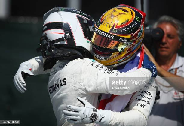 Race winner Lewis Hamilton of Great Britain and Mercedes GP celebrates with second place finisher Valtteri Bottas of Finland and Mercedes GP in parc...