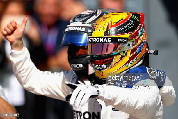 Race winner Lewis Hamilton of Great Britain and Mercedes GP celebrates with second place Valtteri Bottas of Finland and Mercedes GP in parc ferme...