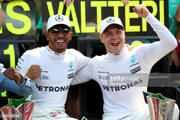Race winner Lewis Hamilton of Great Britain and Mercedes GP celebrates with second place Valtteri Bottas of Finland and Mercedes GP after` the...