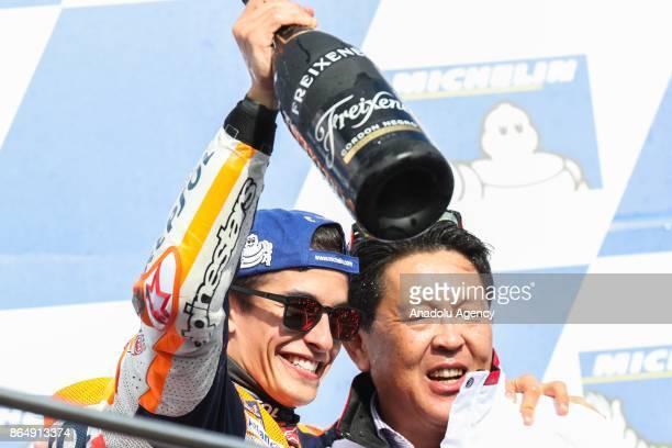 Race winner Marc Marquez of Spain Repsol Honda Team celebrates on the podium with Honda team boss Shuhei Nakamoto during the 2017 MotoGP of Australia...