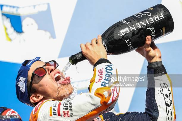 Race winner Marc Marquez of Spain Repsol Honda Team celebrates on the podium by pouring champagne in his mouth during the 2017 MotoGP of Australia...