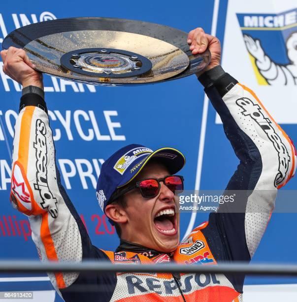 Race winner Marc Marquez of Spain Repsol Honda Team raises the trophy during the 2017 MotoGP of Australia Phillip Island Grand Prix Circuit in...