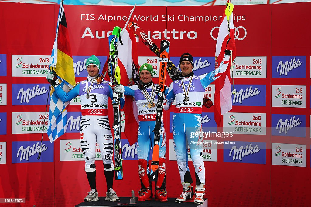 Race winner Marcel Hirscher (C) of Austria celebrates in the finish area with second placed Felix Neureuther (L) of Germany and third placed Mario Matt (R) of Austria following the Men's Slalom during the Alpine FIS Ski World Championships on February 17, 2013 in Schladming, Austria.