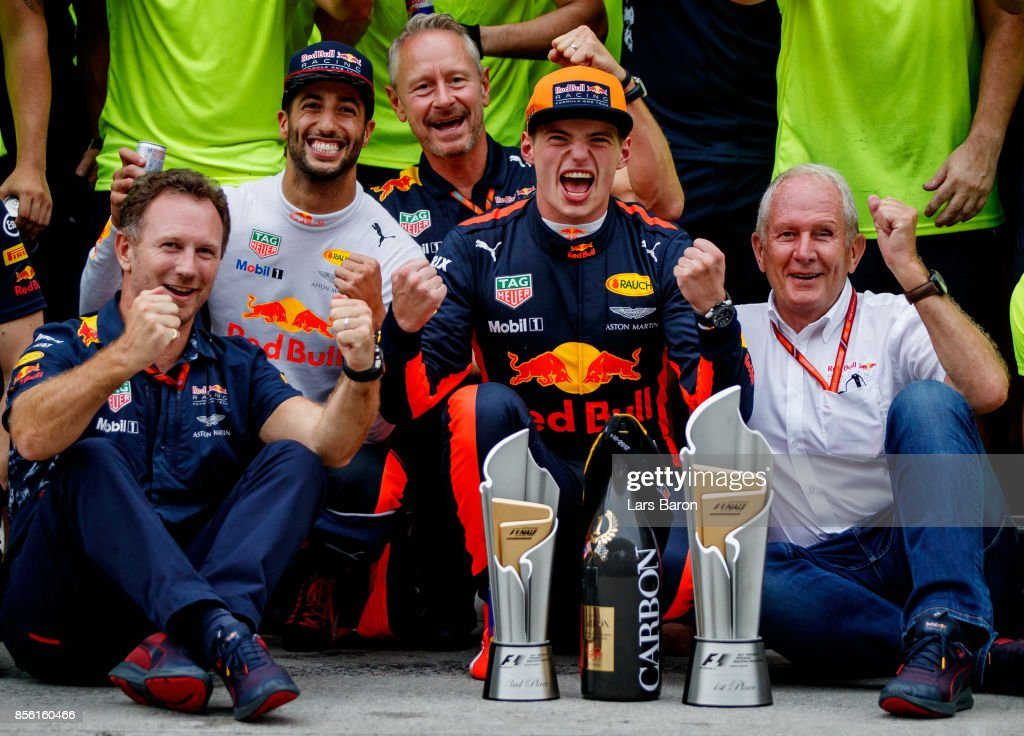 Race winner Max Verstappen of Netherlands and Red Bull Racing, third place finisher Daniel Ricciardo of Australia and Red Bull Racing, Red Bull Racing Team Principal Christian Horner, Red Bull Racing Team Consultant Dr Helmut Marko and the rest of the Red Bull Racing team celebrate after the Malaysia Formula One Grand Prix at Sepang Circuit on October 1, 2017 in Kuala Lumpur, Malaysia.