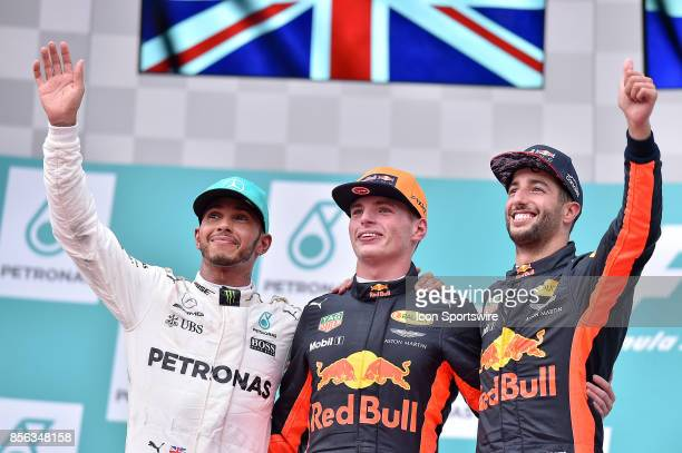 Race winner Max Verstappen of Red Bull Racing celebrates with second place finisher Lewis Hamilton of Mercedes GP and third place finisher Daniel...