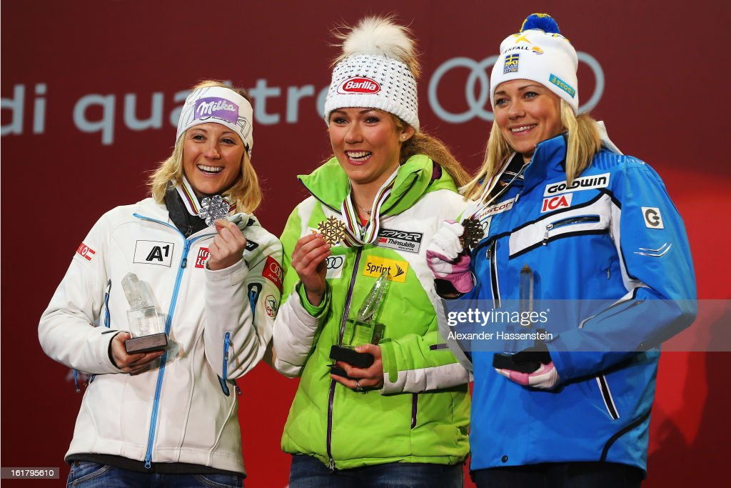 Race winner <a gi-track='captionPersonalityLinkClicked' href=/galleries/search?phrase=Mikaela+Shiffrin&family=editorial&specificpeople=7472698 ng-click='$event.stopPropagation()'>Mikaela Shiffrin</a> (C) of the United States of America celebrates with second placed <a gi-track='captionPersonalityLinkClicked' href=/galleries/search?phrase=Michaela+Kirchgasser&family=editorial&specificpeople=722582 ng-click='$event.stopPropagation()'>Michaela Kirchgasser</a> (R) of Austria and third placed Frida Hansdotter (R) of Sweden at the medal ceremony following the Women's Slalom during the Alpine FIS Ski World Championships on February 16, 2013 in Schladming, Austria.
