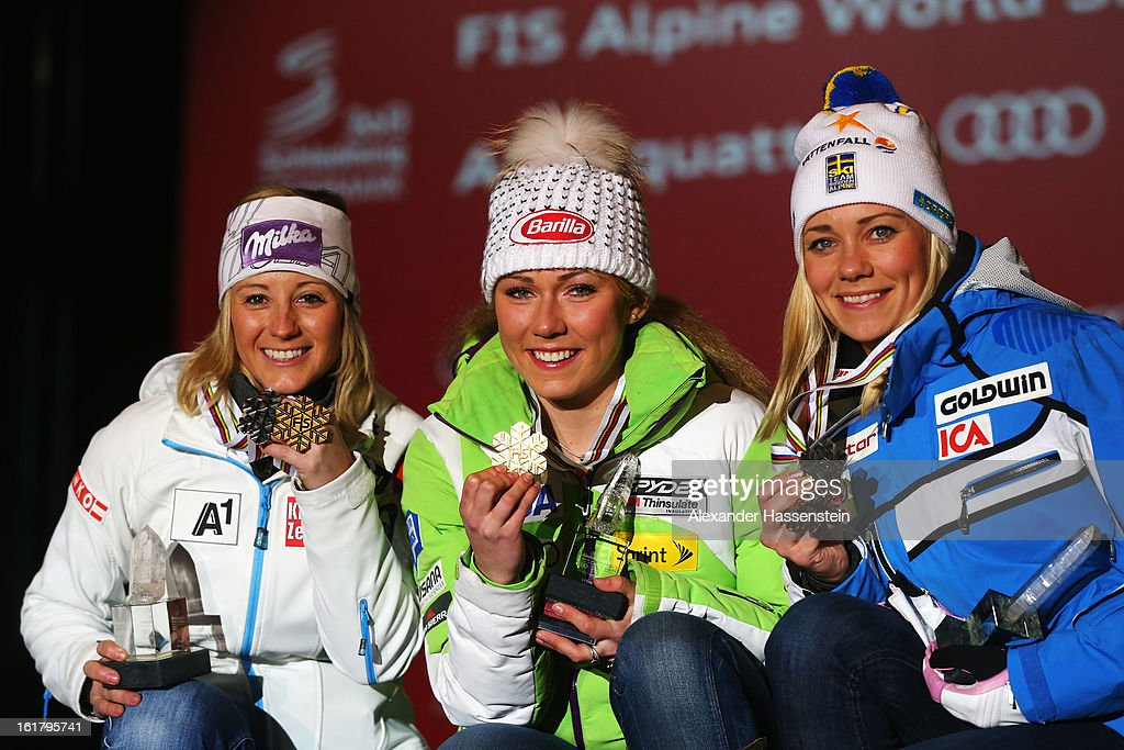 Race winner Mikaela Shiffrin (C) of the United States of America celebrates with second placed Michaela Kirchgasser (R) of Austria and third placed Frida Hansdotter (R) of Sweden at the medal ceremony following the Women's Slalom during the Alpine FIS Ski World Championships on February 16, 2013 in Schladming, Austria.