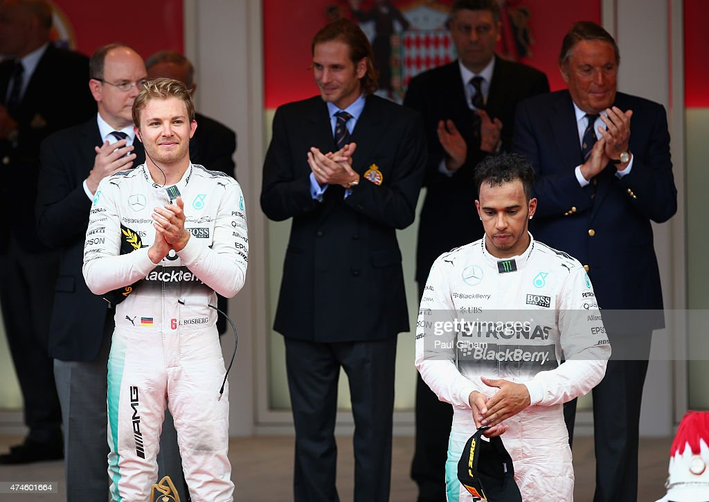 Race winner Nico Rosberg of Germany and Mercedes GP and third placed Lewis Hamilton of Great Britain and Mercedes GP react on the podium following the Monaco Formula One Grand Prix at Circuit de Monaco on May 24, 2015 in Monte-Carlo, Monaco.