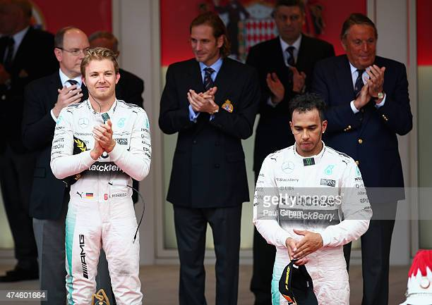 Race winner Nico Rosberg of Germany and Mercedes GP and third placed Lewis Hamilton of Great Britain and Mercedes GP react on the podium following...