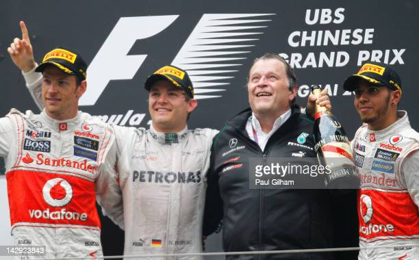 Race winner Nico Rosberg of Germany and Mercedes GP celebrates with second placed Jenson Button of Great Britain and McLaren third placed Lewis...