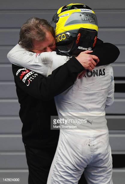 Race winner Nico Rosberg of Germany and Mercedes GP celebrates with Norbert Haug of Mercedes Motorsport in parc ferme following the Chinese Formula...