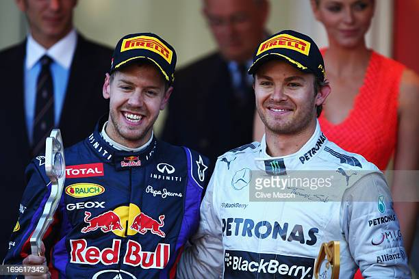 Race winner Nico Rosberg of Germany and Mercedes GP jokes with second placed Sebastian Vettel of Germany and Infiniti Red Bull Racing following the...
