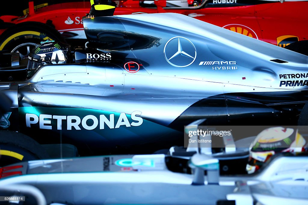 Race winner Nico Rosberg of Germany and Mercedes GP parks next to his team-mate Lewis Hamilton of Great Britain and Mercedes GP in parc ferme after the Formula One Grand Prix of Russia at Sochi Autodrom on May 1, 2016 in Sochi, Russia.