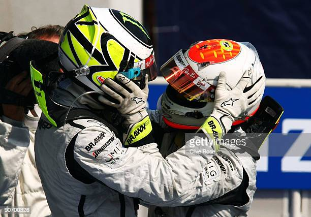 Race winner Rubens Barrichello of Brazil and Brawn GP celebrates with second placed team mate Jenson Button of Great Britain and Brawn GP in parc...