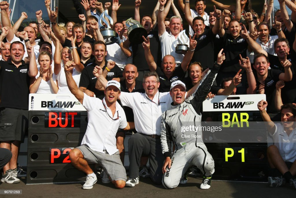 Race winner Rubens Barrichello of Brazil and Brawn GP celebrates with second placed team mate Jenson Button of Great Britain and Brawn GP Team...