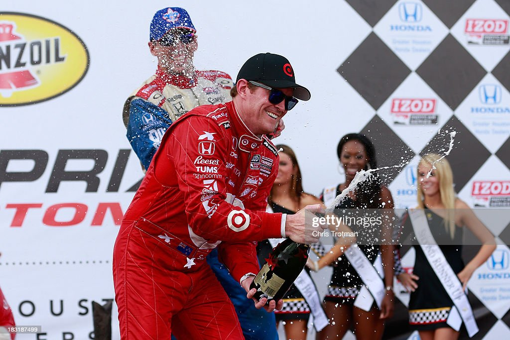 Race winner (L) <a gi-track='captionPersonalityLinkClicked' href=/galleries/search?phrase=Scott+Dixon&family=editorial&specificpeople=183395 ng-click='$event.stopPropagation()'>Scott Dixon</a> of New Zealand, driver of the #9 Target Chip Ganassi Racing Honda Dallara, and third place finisher (R) <a gi-track='captionPersonalityLinkClicked' href=/galleries/search?phrase=Justin+Wilson+-+Race+Car+Driver&family=editorial&specificpeople=11906287 ng-click='$event.stopPropagation()'>Justin Wilson</a> driver of the #19 Dale Coyne Racing Honda Dallara, celebrate with champagne in victory lane following the IZOD IndyCar Series Shell and Pennzoil Grand Prix Of Houston Race 1 at Reliant Park on October 5, 2013 in Houston, Texas.