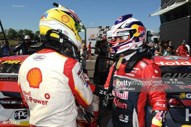 Race winner Scott McLaughlin driver of the Shell VPower Racing Team Ford Falcon FGX is congratulated by 2nd place Jamie Whincup driver of the Red...
