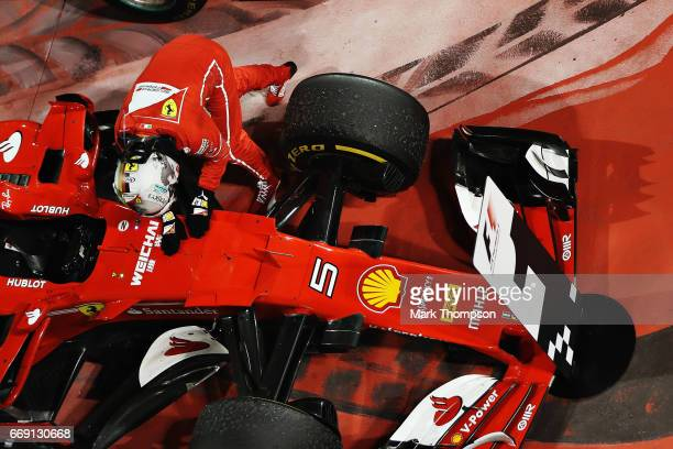 Race winner Sebastian Vettel of Germany and Ferrari celebrates his win in parc ferme during the Bahrain Formula One Grand Prix at Bahrain...