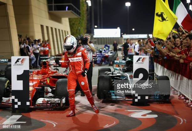 Race winner Sebastian Vettel of Germany and Ferrari celebrates his win in parc ferme during the Bahrain Formula One Grand Prix at Bahrain...