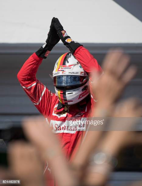 Race winner Sebastian Vettel of Germany and Ferrari celebrates his win in parc ferme during the Formula One Grand Prix of Hungary at Hungaroring on...