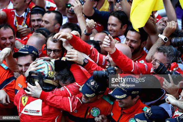 Race winner Sebastian Vettel of Germany and Ferrari celebrates in parc ferme during the Monaco Formula One Grand Prix at Circuit de Monaco on May 28...