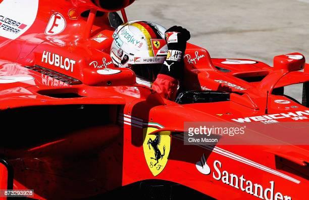 Race winner Sebastian Vettel of Germany and Ferrari celebrates in parc ferme during the Formula One Grand Prix of Brazil at Autodromo Jose Carlos...