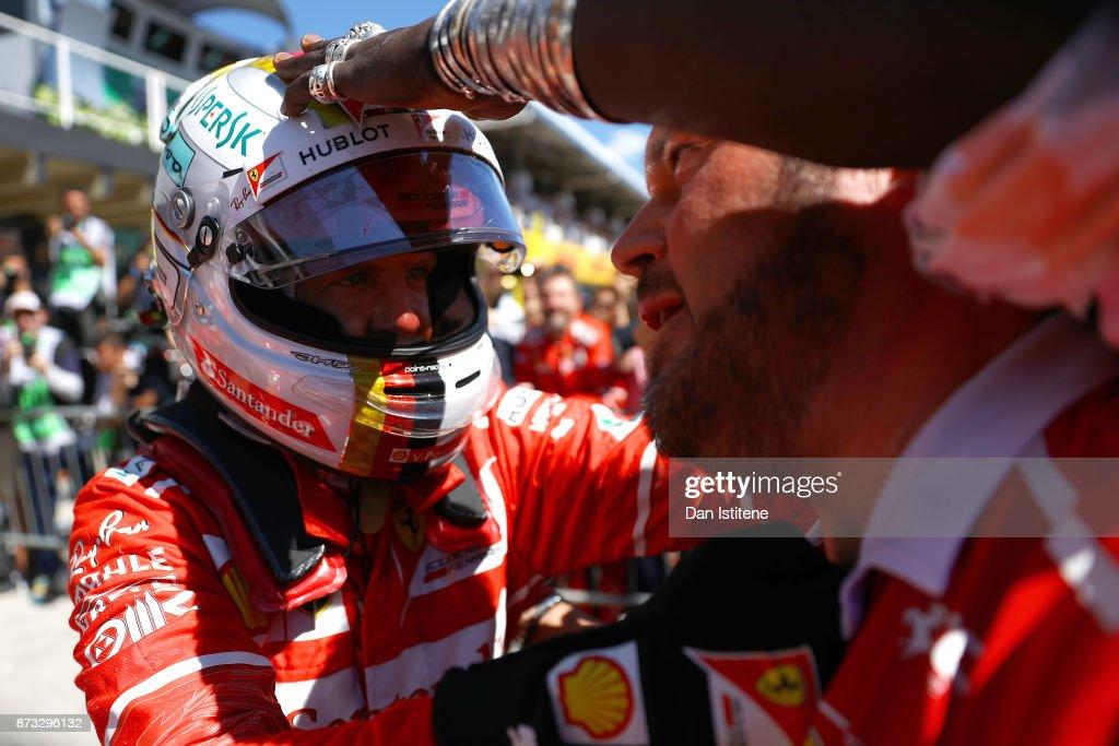 Race winner Sebastian Vettel of Germany and Ferrari celebrates in parc ferme during the Formula One Grand Prix of Brazil at Autodromo Jose Carlos Pace on November 12, 2017 in Sao Paulo, Brazil.