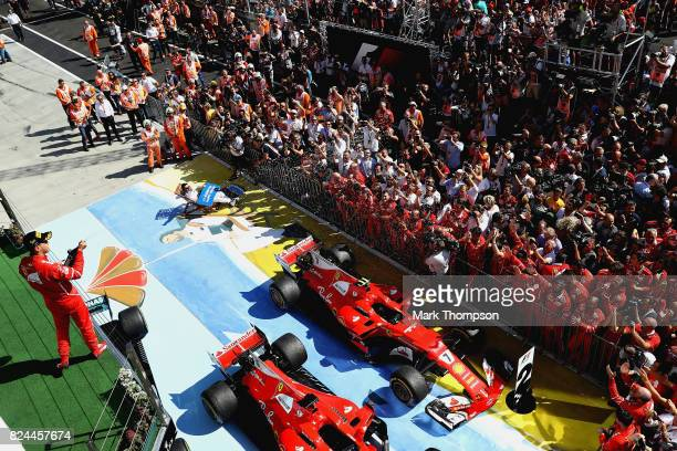 Race winner Sebastian Vettel of Germany and Ferrari celebrates on the podium during the Formula One Grand Prix of Hungary at Hungaroring on July 30...