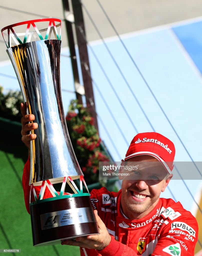 Race winner Sebastian Vettel of Germany and Ferrari celebrates on the podium during the Formula One Grand Prix of Hungary at Hungaroring on July 30, 2017 in Budapest, Hungary.