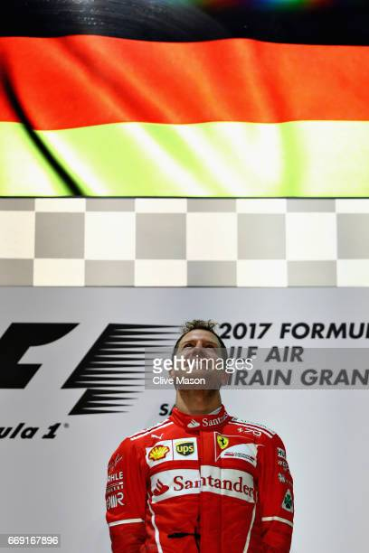Race winner Sebastian Vettel of Germany and Ferrari on the podium during the Bahrain Formula One Grand Prix at Bahrain International Circuit on April...