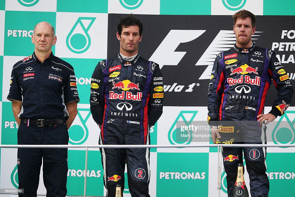 Race winner <a gi-track='captionPersonalityLinkClicked' href=/galleries/search?phrase=Sebastian+Vettel&family=editorial&specificpeople=2233605 ng-click='$event.stopPropagation()'>Sebastian Vettel</a> (R) of Germany and Infiniti Red Bull Racing, second placed <a gi-track='captionPersonalityLinkClicked' href=/galleries/search?phrase=Mark+Webber+-+Race+Car+Driver&family=editorial&specificpeople=167271 ng-click='$event.stopPropagation()'>Mark Webber</a> (C) of Australia and Infiniti Red Bull Racing and Infiniti Red Bull Racing Chief Technical Officer <a gi-track='captionPersonalityLinkClicked' href=/galleries/search?phrase=Adrian+Newey&family=editorial&specificpeople=215410 ng-click='$event.stopPropagation()'>Adrian Newey</a> (L) react on the podium following the Malaysian Formula One Grand Prix at the Sepang Circuit on March 24, 2013 in Kuala Lumpur, Malaysia.