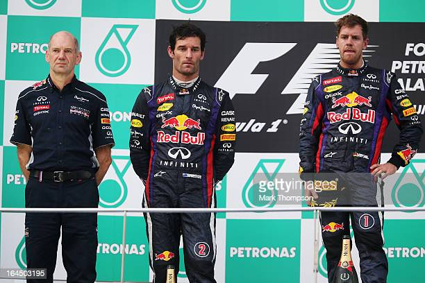 Race winner Sebastian Vettel of Germany and Infiniti Red Bull Racing second placed Mark Webber of Australia and Infiniti Red Bull Racing and Infiniti...