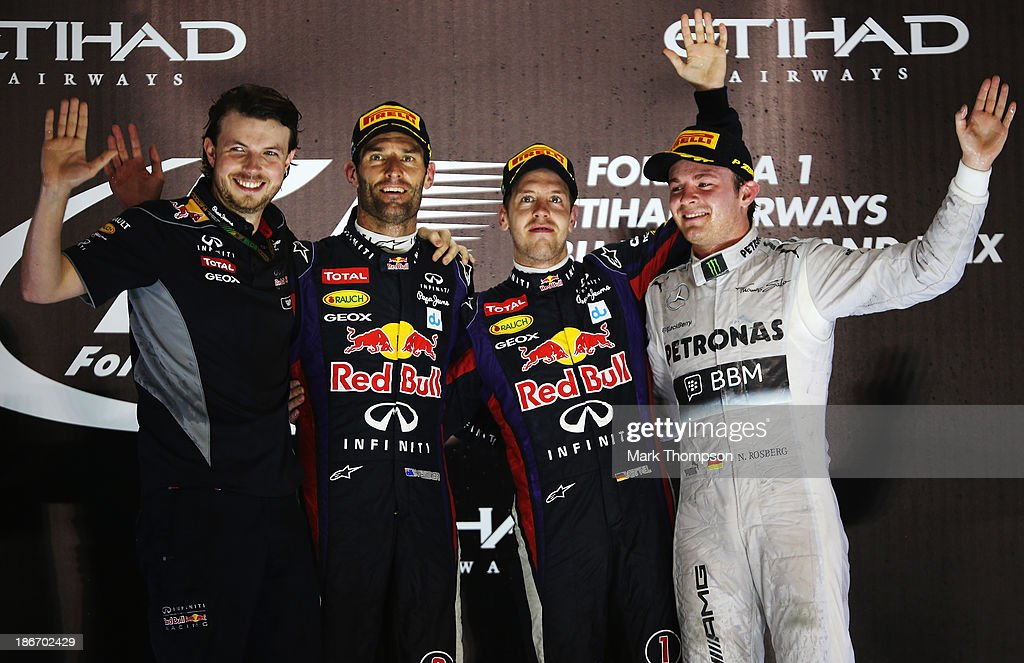 Race winner <a gi-track='captionPersonalityLinkClicked' href=/galleries/search?phrase=Sebastian+Vettel&family=editorial&specificpeople=2233605 ng-click='$event.stopPropagation()'>Sebastian Vettel</a> (C) of Germany and Infiniti Red Bull Racing celebrates on the podium with second placed <a gi-track='captionPersonalityLinkClicked' href=/galleries/search?phrase=Mark+Webber+-+Race+Car+Driver&family=editorial&specificpeople=167271 ng-click='$event.stopPropagation()'>Mark Webber</a> (2nd L) of Australia and Infiniti Red Bull Racing, third placed <a gi-track='captionPersonalityLinkClicked' href=/galleries/search?phrase=Nico+Rosberg&family=editorial&specificpeople=800808 ng-click='$event.stopPropagation()'>Nico Rosberg</a> (R) of Germany and Mercedes GP and Gavin Ward (L) of Infiniti Red Bull Racing after winning the Abu Dhabi Formula One Grand Prix at the Yas Marina Circuit on November 3, 2013 in Abu Dhabi, United Arab Emirates.