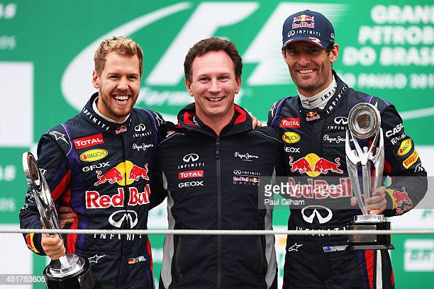 Race winner Sebastian Vettel of Germany and Infiniti Red Bull Racing second placed team mate Mark Webber of Australia and Infiniti Red Bull Racing...