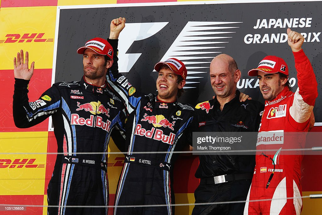 Race winner Sebastian Vettel (2nd left) of Germany and Red Bull Racing, second placed Mark Webber (left) of Australia and Red Bull Racing, Red Bull Racing Chief Technical Officer Adrian Newey (2nd right) and third placed Fernando Alonso (right) of Spain and Ferrari celebrate on the podium after the Japanese Formula One Grand Prix at Suzuka Circuit on October 10, 2010 in Suzuka, Japan.