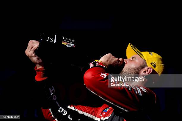 Race winner Shane Van Gisbergen driver of the Red Bull Holden Racing Team Holden Commodore VF celebrates on the podium after race 1 for the Clipsal...