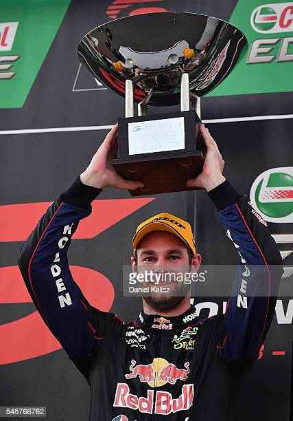 Race winner Shane Van Gisbergen driver of the Red Bull Racing Australia Holden Commodore VF celebrates after race 2 for the Townsville 400 at Reid...