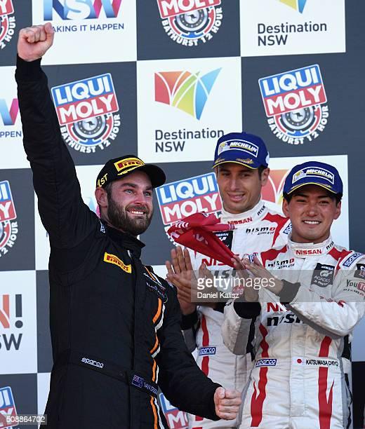 Race winner Shane van Gisbergen driver of the Tekno Autosport McLaren 650S celebrates on the podium after the Bathurst 12 Hour Race at Mount Panorama...