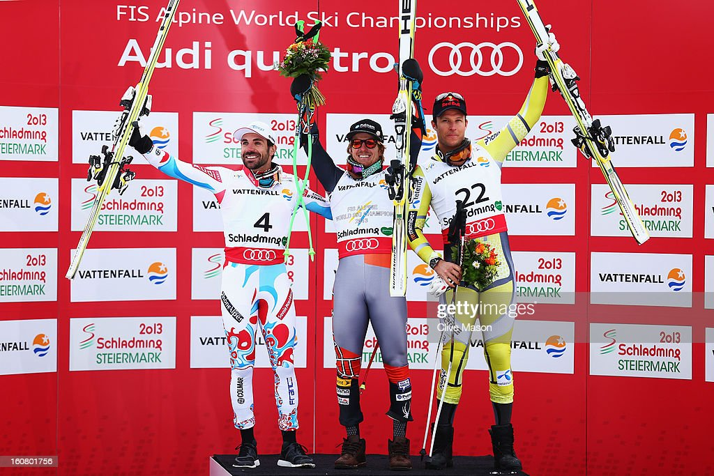 Race winner Ted Ligety (C) of the United States of America celebrates at the flower ceremony with second placed Gauthier De Tessieres (L) of France and third placed Aksel Lund Svindal (R) of Norway following the Men's Super G event during the Alpine FIS Ski World Championships on February 6, 2013 in Schladming, Austria.