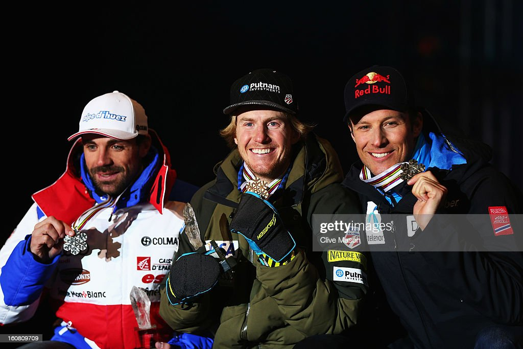Race winner Ted Ligety (C) of the United States of America celebrates at the medal ceremony with second placed Gauthier De Tessieres (L) of France and third placed Aksel Lund Svindal (R) of Norway following the Men's Super G event during the Alpine FIS Ski World Championships on February 6, 2013 in Schladming, Austria.