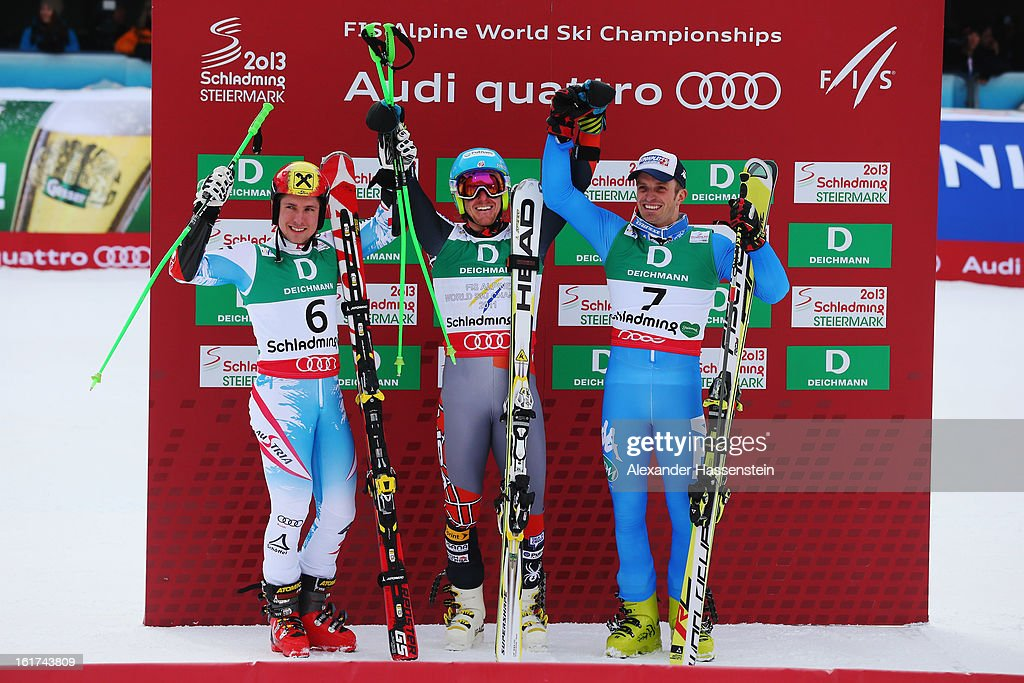 Race winner Ted Ligety (C) of the United States of America celebrates with second placed Marcel Hirscher (L) of Austria and third placed Manfred Moelgg (R) of Italy in the finish area following the Men's Giant Slalom during the Alpine FIS Ski World Championships on February 15, 2013 in Schladming, Austria.