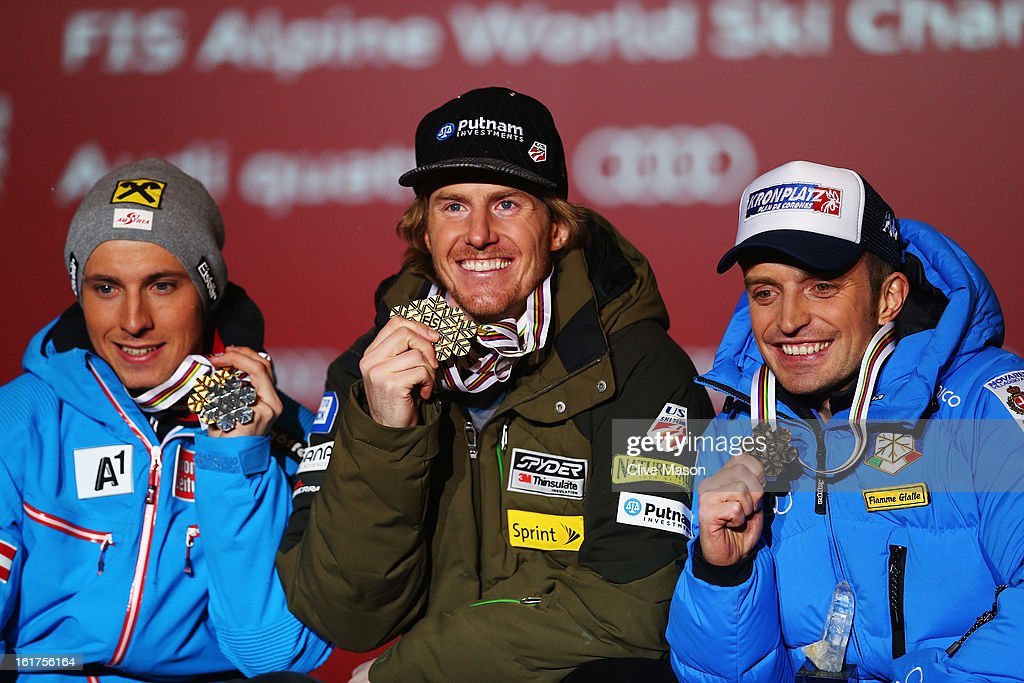 Race winner Ted Ligety (C) of the United States of America celebrates with second placed Marcel Hirscher (L) of Austria and third placed Manfred Moelgg (R) of Italy at the medal ceremony following the Men's Giant Slalom during the Alpine FIS Ski World Championships on February 15, 2013 in Schladming, Austria.