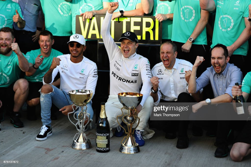 Race winner Valtteri Bottas of Finland and Mercedes GP, celebrates his win with team mate Lewis Hamilton of Great Britain and Mercedes GP and the rest of the Mercedes GP team during the Formula One Grand Prix of Russia on April 30, 2017 in Sochi, Russia.