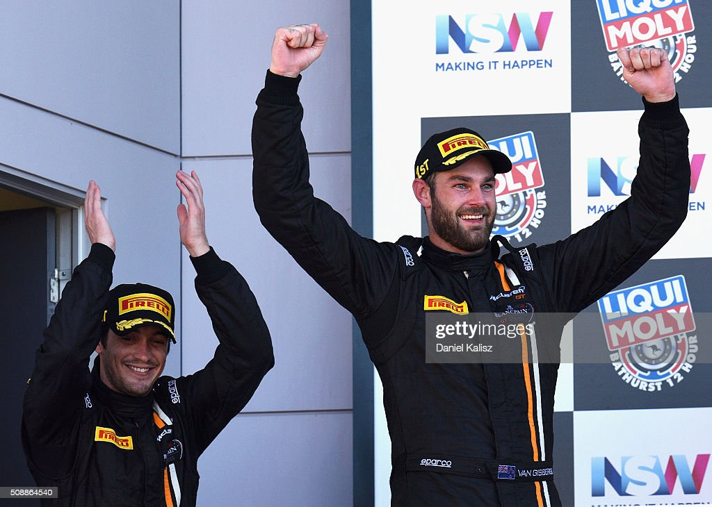 Race winners Shane van Gisbergen and <a gi-track='captionPersonalityLinkClicked' href=/galleries/search?phrase=Alvaro+Parente&family=editorial&specificpeople=781386 ng-click='$event.stopPropagation()'>Alvaro Parente</a> drivers of the #59 Tekno Autosport McLaren 650S celebrates on the podium after the Bathurst 12 Hour Race at Mount Panorama on February 7, 2016 in Bathurst, Australia.