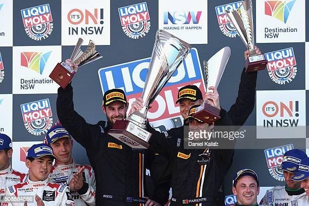 Race winners Shane van Gisbergen Jonathon Webb and Alvaro Parente drivers of the Tekno Autosport McLaren 650S celebrate on the podium after the...