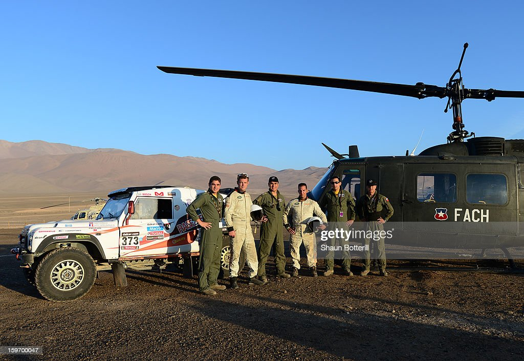 Race2Recovery members Mark Zambon (3rd R) and Tony Harris (2nd R) pose with Chilean helicopter pilots before stage 13 from Copiapo to La Serena during the 2013 Dakar Rally on January 18, 2013 in Copiapo, Argentina.