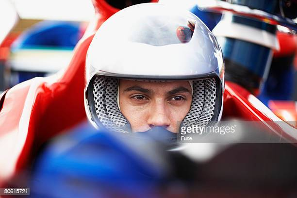 Racecar Driver Preparing for a Race