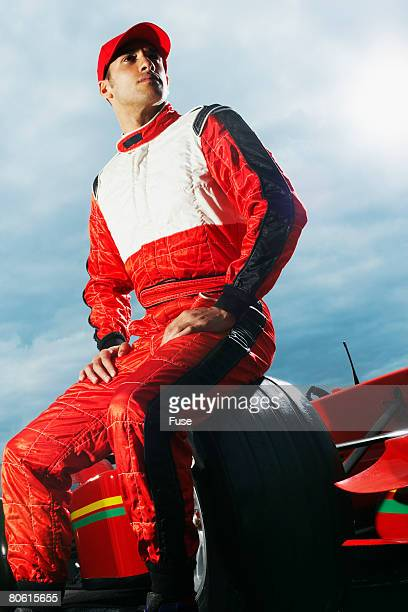Racecar Driver Sitting on Racecar