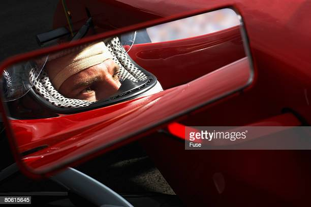 Racecar Driver's Reflection in Side-View Mirror